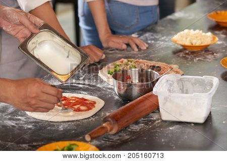 Pizza making process: adding different tasty sauces