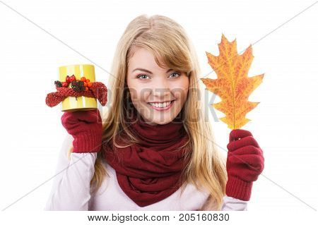 Happy Smiling Girl In Gloves Holding Decorated Cup Of Tea And Autumnal Leaf