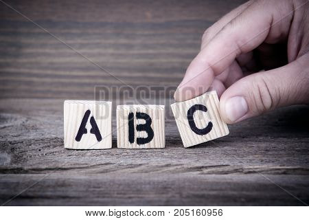 abc. Wooden letters on the office desk, informative and communication background.