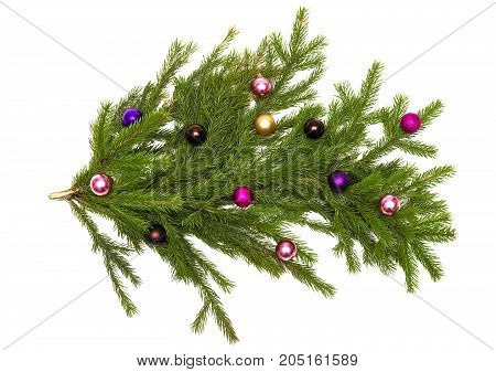 Fir tree branches with Christmas balls isolated on white background. Christmas decoration.