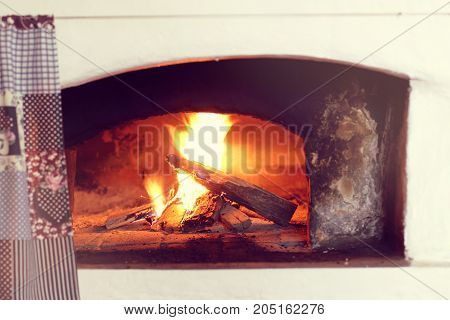 burning firewood in a large Russian stove / warming atmosphere in retro style
