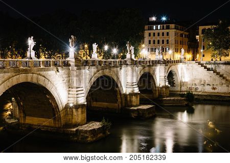 Rome, Italy - August 20, 2016:  Bridge of Castel Sant Angelo at night. The Mausoleum of Hadrian, usually known as Castel Sant'Angelo is a towering cylindrical building in Rome