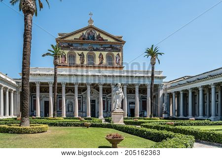 Rome, Italy - August 21, 2016: Outdoors view of the Papal Basilica of St. Paul outside the Walls . It is one of Rome's four  major basilicas.