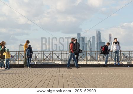 Moscow, Russia - October 1. 2016. People on aobservation deck on background of skyscrapers of Moscow City