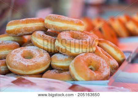 Delicious Fresh Doughnuts Or Donuts With Sugar Topping In A Street Market Or Funfair