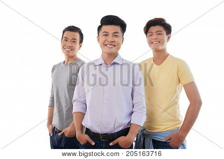 Portrait of three handsome young Asian men, isolated on white