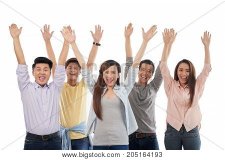 Happy excited colleagues rising hands and shouting