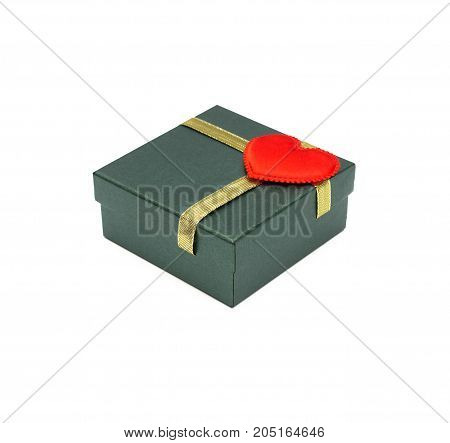 Christmas present box with gold ribbon and red heart on cover isolated on white background.