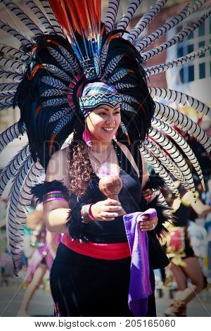 Woman In Traditional Mexican Feathers In San Francisco Parade