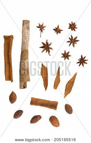 Cinnamon, nutmeg and star anise on white background