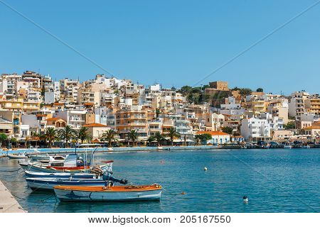 Sitia, Crete, Greece - June 11, 2017: Seaport Of Sitia Town With Moored Traditional Greek Fishing Bo