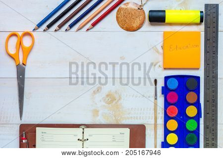 Top view of education and business supplies on white wooden tableEducation concepe.Copy space.