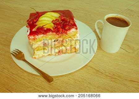 A piece cake on dish with currant in a relaxing time. Close up cake with red currant - Retro color