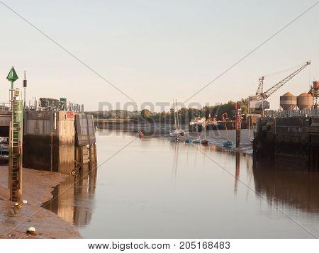 Sunset Light Scene Over Dock Gate Open With Moored Boats River