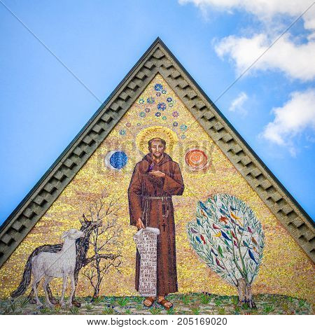 Mosaic of Saint Francis of Assisi against blue sky