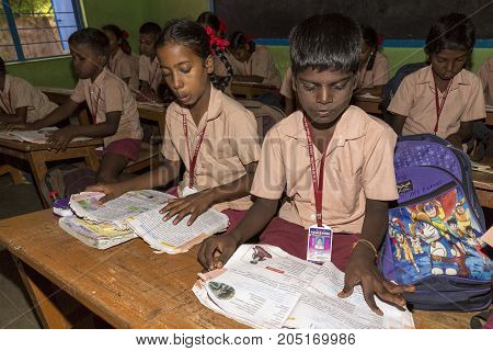 PONDICHERY PUDUCHERY INDIA - STEPEMBER 04 2017. Unidentified children boys girls with school uniform study in classroom with books. Government public school.