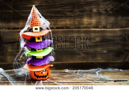 Halloween Card Concept With Pumpkin Head And Stack Of Cute Littl