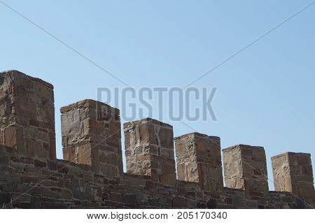 Old wall with battlement in Sudak fortress Crimea