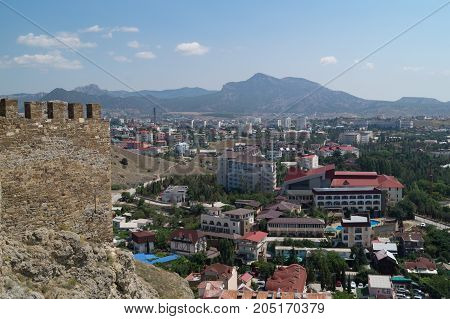 Sudak Crimea Russia June 29 2017: View from the loophole of the fortress on town named Sudak from the fortres.