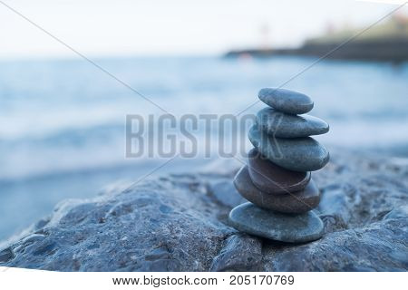 Pebble tower on the seaside. Reax concept