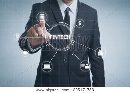 Businessman with fintech icon and internet of things with matrix code background Investment and financial internet technology concept.