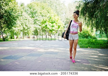 Sport Girl Wear On White Shorts Ans Shirt With Sport Bag Walking At Park.