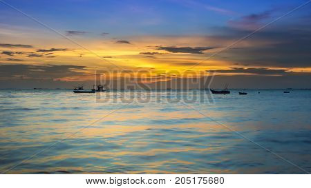 Fishing boat over the sea with a beautiful sunrise Thailand