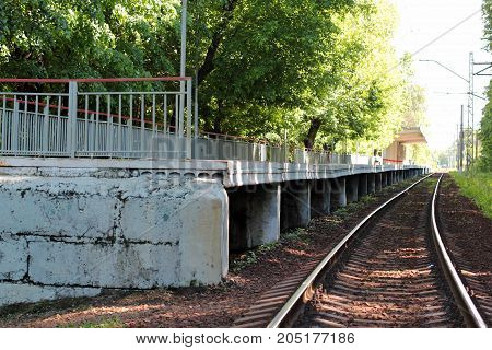 Abandoned station train platform in the woods