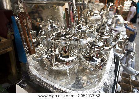 Silver Tea Pots at Tetouan souk Morocco. Shinny tray for sell