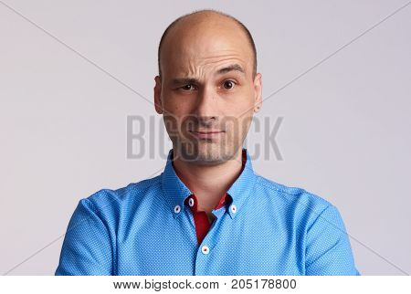 Confused Bald Man Raised Eyebrow.