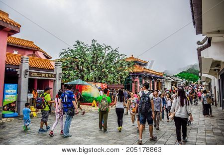 HONG KONG - MAY 31: Tourists visiting Ngong Ping Village, one of the most popular tourist destination in Lantau Island, Hong Kong