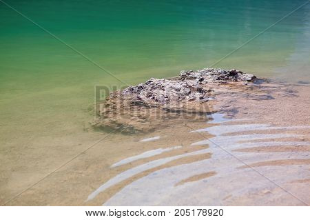 transparent water of lake , view of surface and bottom