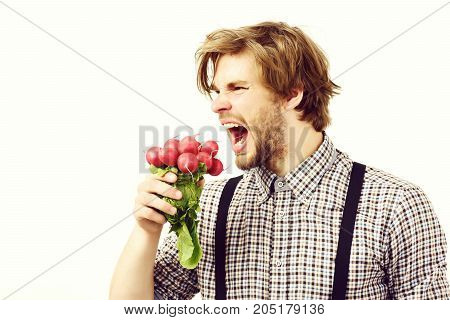 Man With Angry Face And Beard Holds Bunch Of Radish