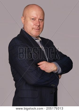 Old Businessman Looking At Camera Isolated