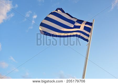 Greek national flag waving on the wind