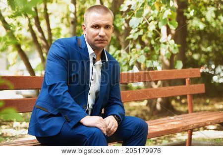 Portrait Of A Businessman In The Park