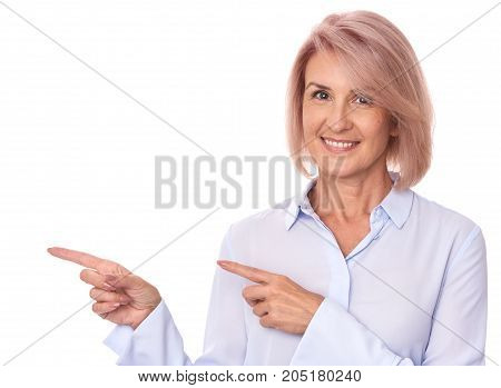 Beautiful Senior Woman Pointing Finger