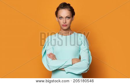 Beautiful Woman Over Orange Background