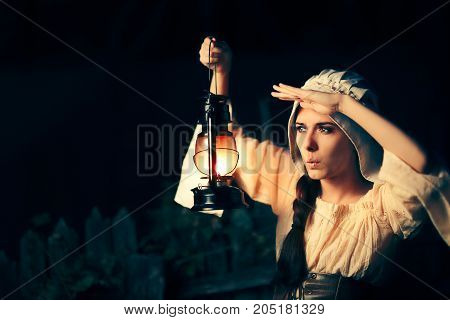 Curious Medieval Woman with Vintage Lantern Outside at Night