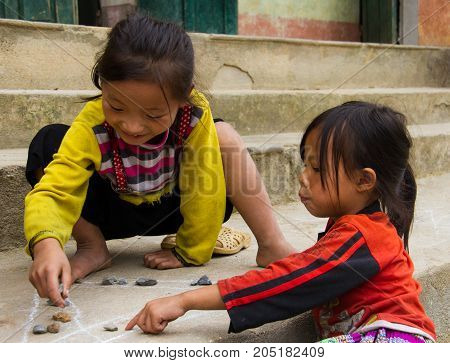 Children Play Game With Chalk And Rocks In North Vietnam
