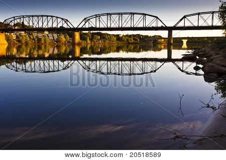 Reflection On The Calm River