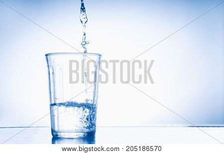 Glass of water on the bar table on white background