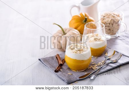 Healthy breakfast with overnight oats and pumpkin smoothie yogurt vegetarian eating copy space