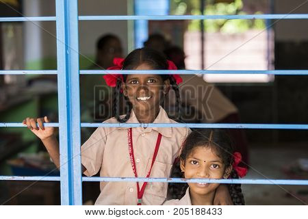 PONDICHERY PUDUCHERY INDIA - SEPTEMBER 04 2017. Unidentified child at schhol behind the window