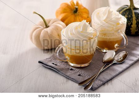 Pumpkin latte hot caffee drink with pumpkins whipped cream and spices