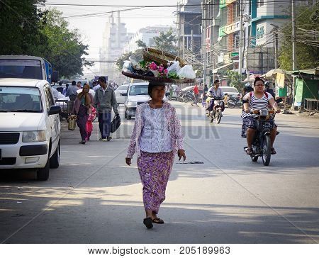 A Woman Walking On Sreet In Yangon, Myanmar