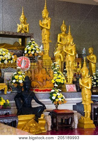 Kanchanaburi Thailand May 17 2013: A monk sits in a Buddhist temple.