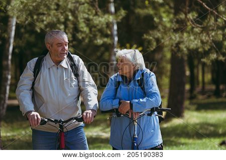 Senior retired couple riding bikes in nature, active lifestyle