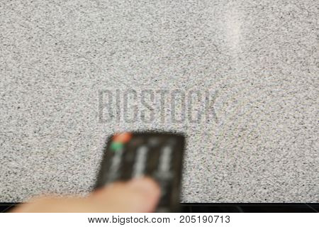blurry hand press television remote control for searching signal