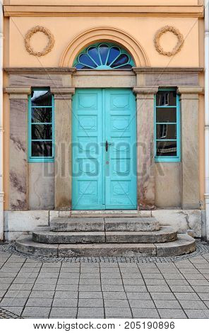 Old turquois door with ornaments germany europe